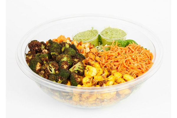Roasted and raw vegetables with wild rice and green goddess dressing bowl