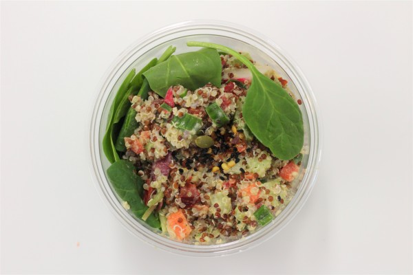 Quinoa, chopped vegetables and fresh herbs