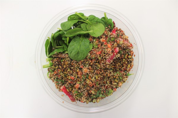 Quinoa, chopped vegetables and fresh herbs bowl