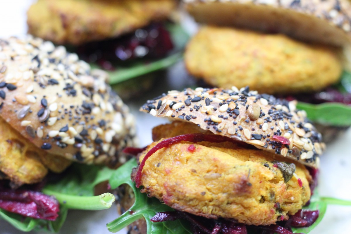 Mini sweet potato & cauliflower cake, pickled beetroot and jalapeño aioli on a seeded potato roll