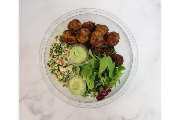 Vegetable cakes, raw cauliflower & green tahini bowl